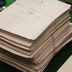 frontpg-paper-stack-health-care-bill